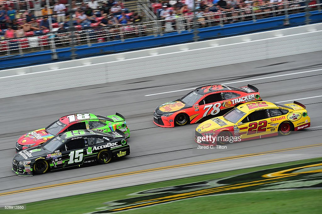 Kyle Busch, driver of the #18 Skittles Marvel Toyota, races Clint Bowyer, driver of the #15 AccuDoc Solutions Chevrolet, ahead of Joey Logano, driver of the #22 Shell Pennzoil Ford, and Martin Truex Jr, driver of the #78 Bass Pro Shops/TRACKER Boats Toyota, during the NASCAR Sprint Cup Series GEICO 500 at Talladega Superspeedway on May 1, 2016 in Talladega, Alabama.