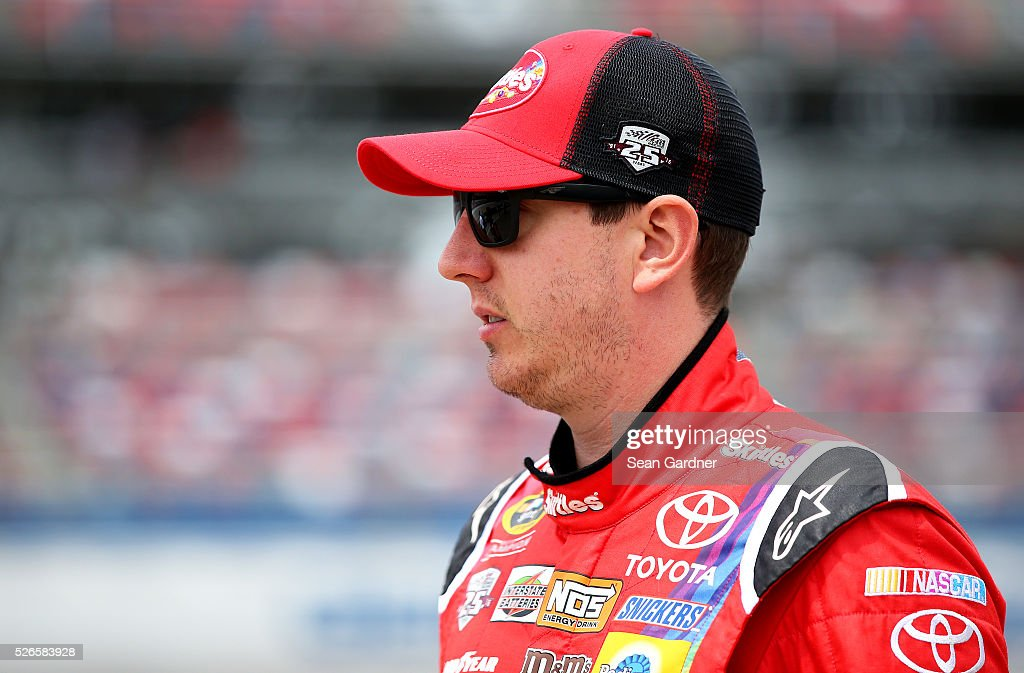 <a gi-track='captionPersonalityLinkClicked' href=/galleries/search?phrase=Kyle+Busch&family=editorial&specificpeople=211123 ng-click='$event.stopPropagation()'>Kyle Busch</a>, driver of the #18 Skittles Marvel Toyota, stands on the grid during qualifying for the NASCAR Sprint Cup Series GEICO 500 at Talladega Superspeedway on April 30, 2016 in Talladega, Alabama.