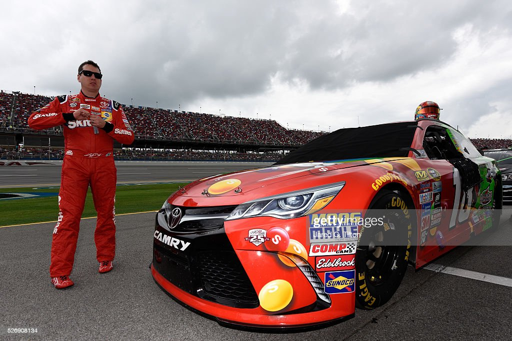 <a gi-track='captionPersonalityLinkClicked' href=/galleries/search?phrase=Kyle+Busch&family=editorial&specificpeople=211123 ng-click='$event.stopPropagation()'>Kyle Busch</a>, driver of the #18 Skittles Marvel Toyota, stands on the grid prior to the NASCAR Sprint Cup Series GEICO 500 at Talladega Superspeedway on May 1, 2016 in Talladega, Alabama.