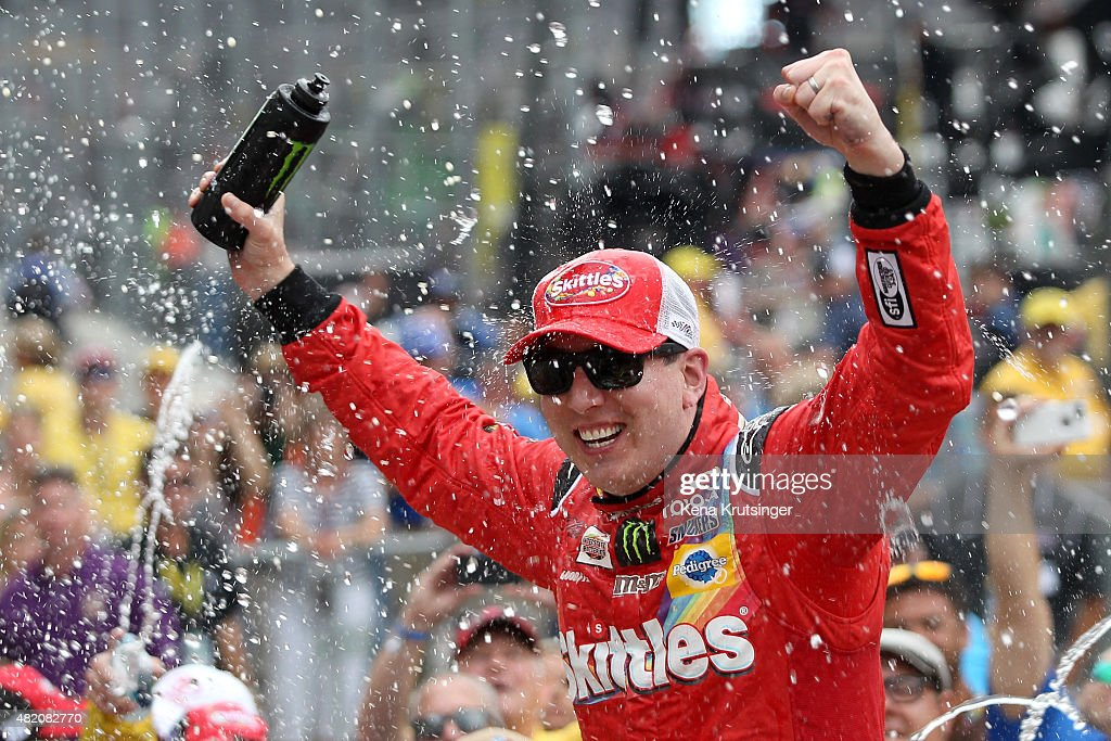 Kyle Busch, driver of the #18 Skittles Toyota, celebrates in Victory Lane after winning the NASCAR Sprint Cup Series Crown Royal Presents the Jeff Kyle 400 at the Brickyard at Indianapolis Motor Speedway on July 26, 2015 in Indianapolis, Indiana.