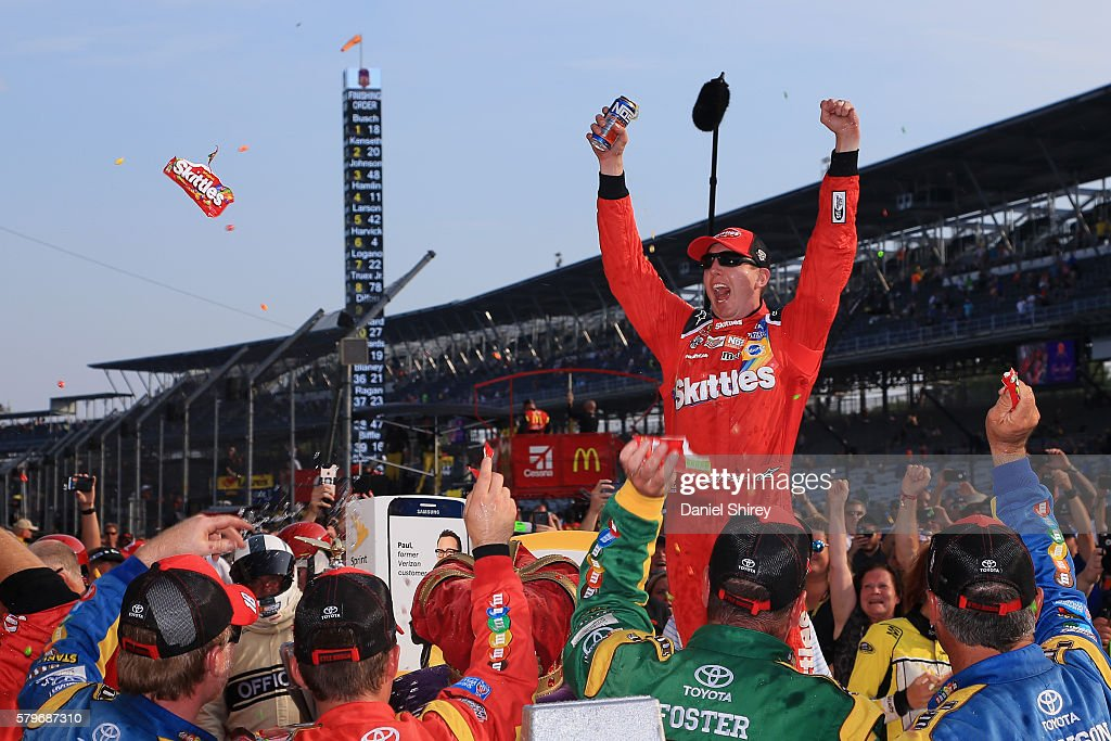 Kyle Busch, driver of the #18 Skittles Toyota, celebrates in victory lane after winning the NASCAR Sprint Cup Series Crown Royal Presents the Combat Wounded Coalition 400 at Indianapolis Motor Speedway on July 24, 2016 in Indianapolis, Indiana.