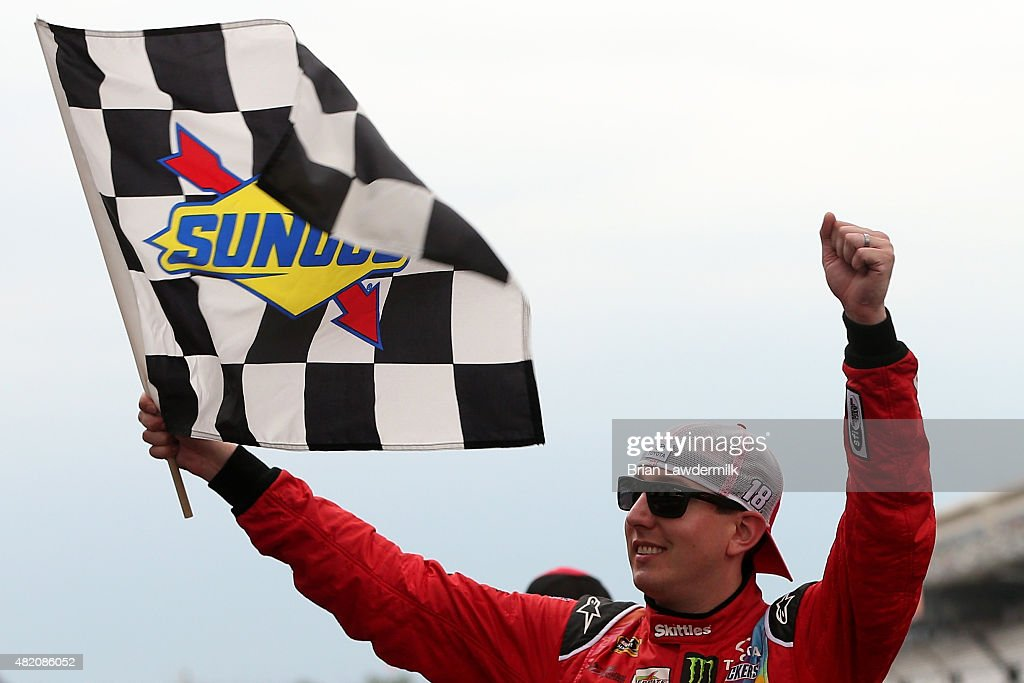<a gi-track='captionPersonalityLinkClicked' href=/galleries/search?phrase=Kyle+Busch&family=editorial&specificpeople=211123 ng-click='$event.stopPropagation()'>Kyle Busch</a>, driver of the #18 Skittles Toyota, celebrates with the checkered flag after winning the NASCAR Sprint Cup Series Crown Royal Presents the Jeff Kyle 400 at the Brickyard at Indianapolis Motor Speedway on July 26, 2015 in Indianapolis, Indiana.