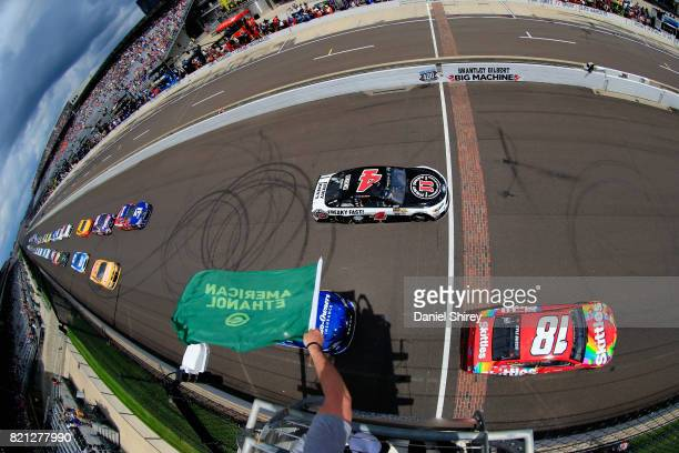 Kyle Busch driver of the Skittles Toyota leads the field past the green flag to start the Monster Energy NASCAR Cup Series Brickyard 400 at...