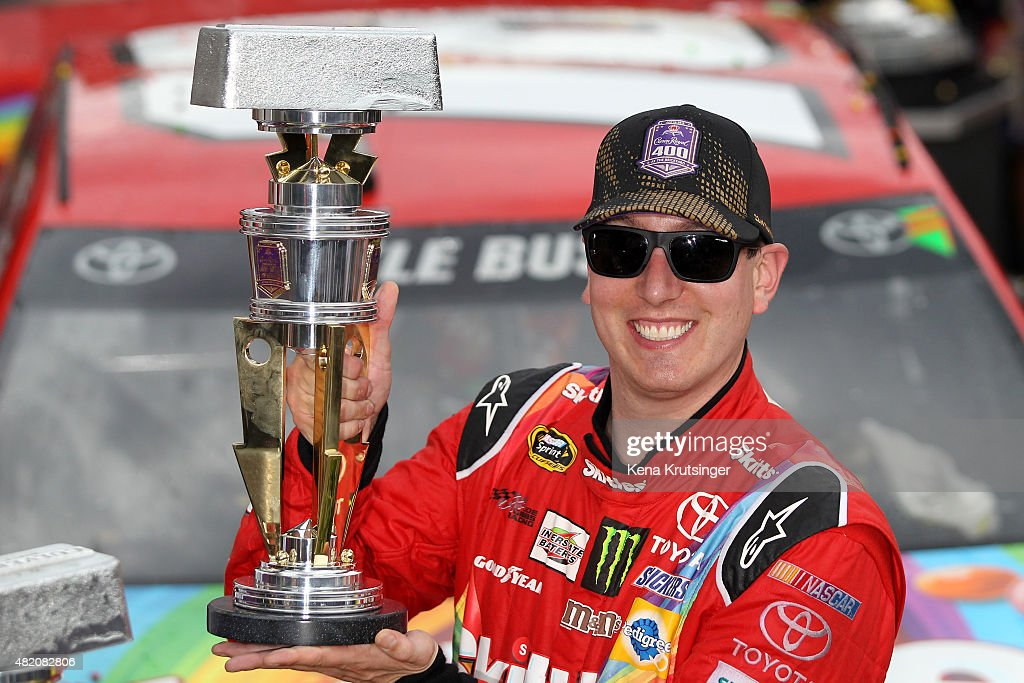 <a gi-track='captionPersonalityLinkClicked' href=/galleries/search?phrase=Kyle+Busch&family=editorial&specificpeople=211123 ng-click='$event.stopPropagation()'>Kyle Busch</a>, driver of the #18 Skittles Toyota, poses with the trophy in Victory Lane after winning the NASCAR Sprint Cup Series Crown Royal Presents the Jeff Kyle 400 at the Brickyard at Indianapolis Motor Speedway on July 26, 2015 in Indianapolis, Indiana.