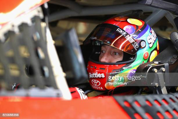 Kyle Busch driver of the Skittles Toyota sits in his car during practice for the Monster Energy NASCAR Cup Series Brickyard 400 at Indianapolis...