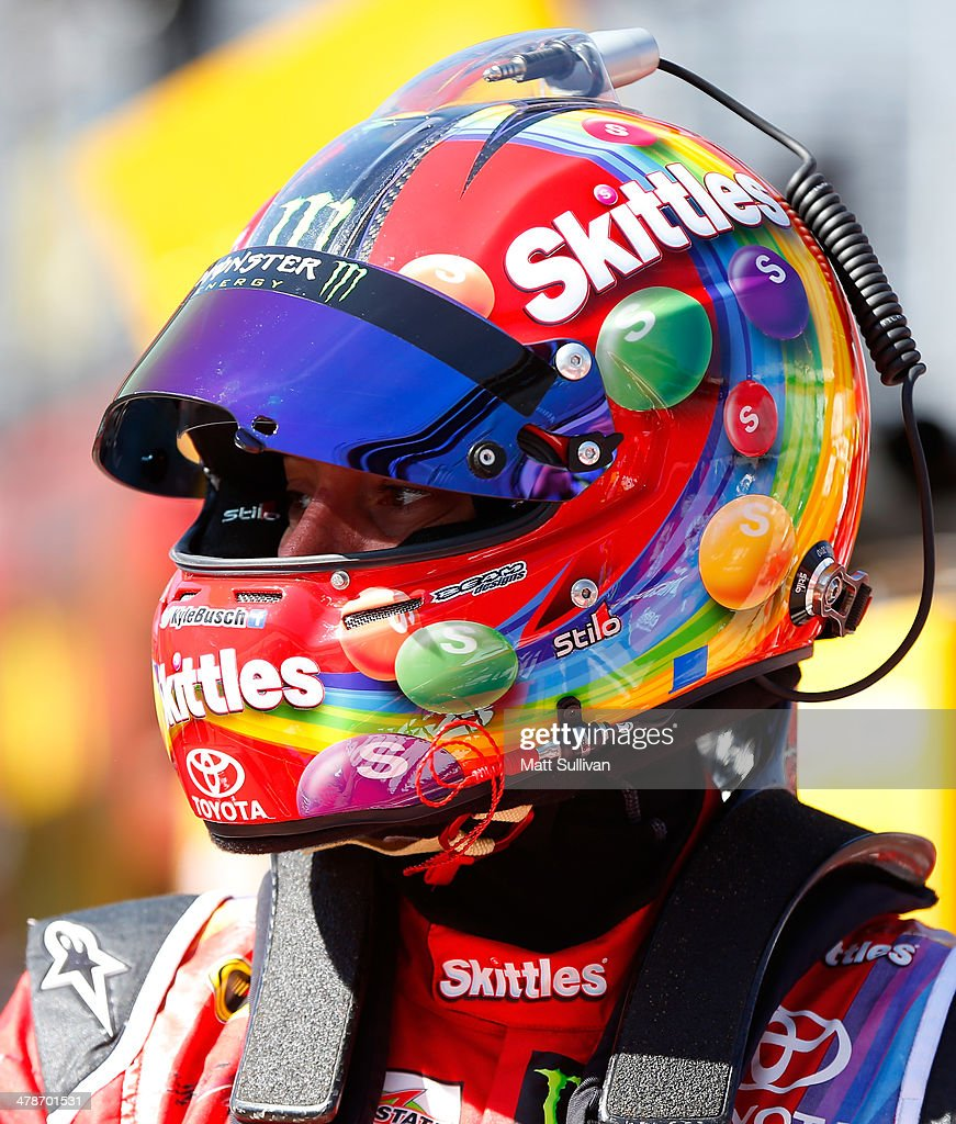 <a gi-track='captionPersonalityLinkClicked' href=/galleries/search?phrase=Kyle+Busch&family=editorial&specificpeople=211123 ng-click='$event.stopPropagation()'>Kyle Busch</a>, driver of the #18 Skittles Toyota, stands in the garage area during practice for the NASCAR Sprint Cup Series Food City 500 at Bristol Motor Speedway on March 14, 2014 in Bristol, Tennessee.