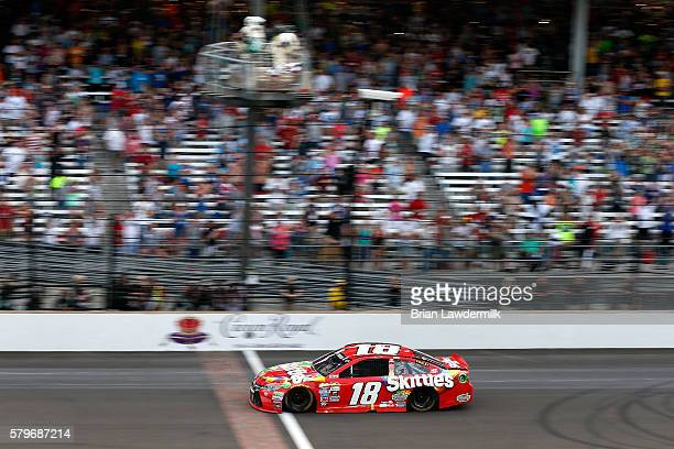 Kyle Busch driver of the Skittles Toyota takes the checkered flag to win the NASCAR Sprint Cup Series Crown Royal Presents the Combat Wounded...