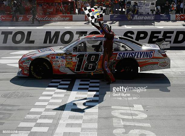 Kyle Busch driver of the Snickers Toyota celebrates on the track after winning the NASCAR Sprint Cup Series Food City 500 at Bristol Motor Speedway...