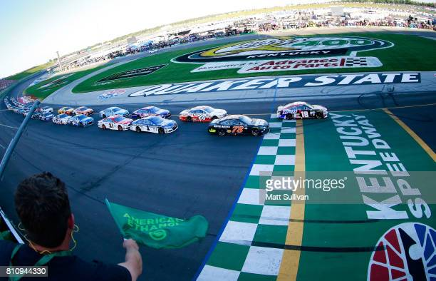 Kyle Busch driver of the Snickers Toyota leads Martin Truex Jr driver of the Furniture Row/Denver Mattress Toyota and the rest of the field at the...