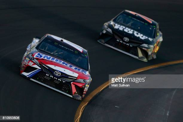 Kyle Busch driver of the Snickers Toyota leads Martin Truex Jr driver of the Furniture Row/Denver Mattress Toyota during the Monster Energy NASCAR...