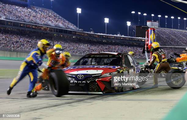 Kyle Busch driver of the Snickers Toyota pits during the Monster Energy NASCAR Cup Series Quaker State 400 presented by Advance Auto Parts at...