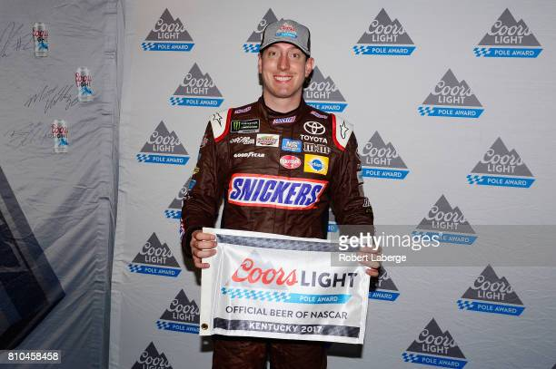 Kyle Busch driver of the Snickers Toyota poses for a photo after winning the pole award during qualifying for the Monster Energy NASCAR Cup Series...