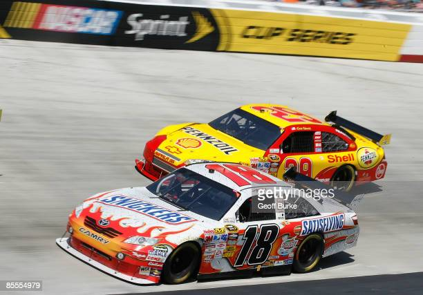 Kyle Busch driver of the Snickers Toyota races Kevin Harvick driver of the Shell/Pennzoil Chevrolet during the NASCAR Sprint Cup Series Food City 500...
