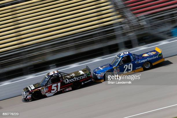 Kyle Busch driver of the Textron Off Road Toyota leads Chase Briscoe driver of the Cooper Standard Ford during the NASCAR Camping World Truck Series...