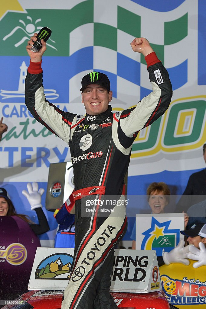 <a gi-track='captionPersonalityLinkClicked' href=/galleries/search?phrase=Kyle+Busch&family=editorial&specificpeople=211123 ng-click='$event.stopPropagation()'>Kyle Busch</a>, driver of the #51 Toyota Care Toyota, celebrates in Victory Lane after winning the NASCAR Camping World Truck Series North Carolina Education Lottery 200 at Charlotte Motor Speedway on May 17, 2013 in Concord, North Carolina.