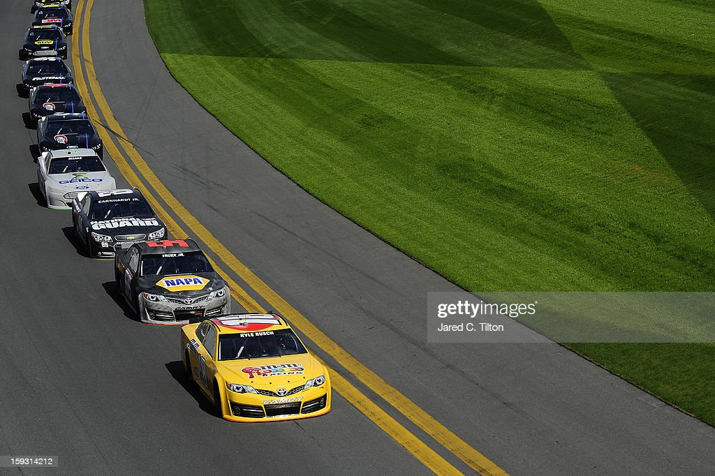 Kyle Busch, driver of the #18 Toyota, leads a group of cars during NASCAR Sprint Cup Series Preseason Thunder testing at Daytona International Speedway on January 11, 2013 in Daytona Beach, Florida.