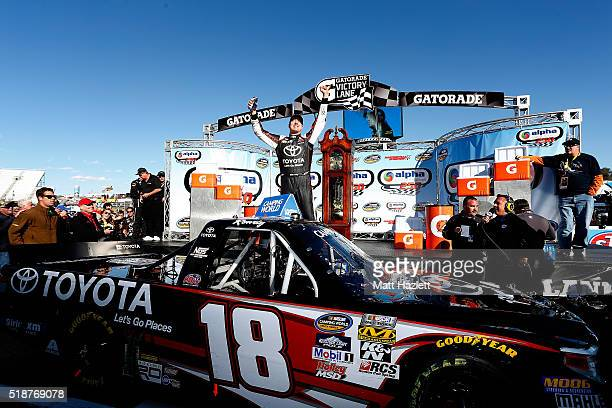 Kyle Busch driver of the Toyota Toyota celebrates in victory lane after winning the NASCAR Camping World Truck Series Alpha Energy Solutions 250 at...
