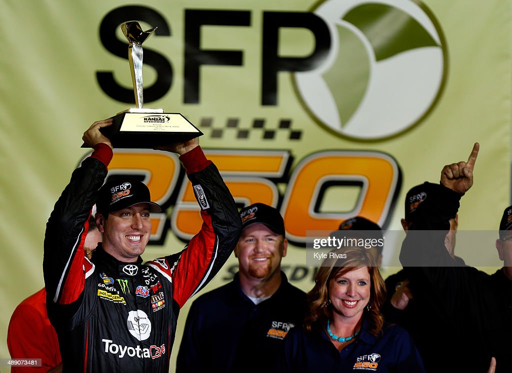 <a gi-track='captionPersonalityLinkClicked' href=/galleries/search?phrase=Kyle+Busch&family=editorial&specificpeople=211123 ng-click='$event.stopPropagation()'>Kyle Busch</a>, driver of the #51 ToyotaCare Toyota, poses in victory lane after winning the NASCAR Camping World Truck Series SFP 250 at Kansas Speedway on May 9, 2014 in Kansas City, Kansas.