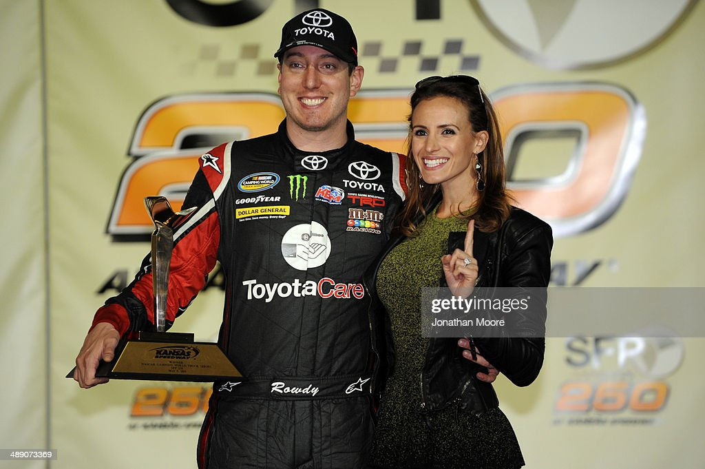 Kyle Busch, driver of the #51 ToyotaCare Toyota, poses with his wife, Samantha, in victory lane after winning the NASCAR Camping World Truck Series SFP 250 at Kansas Speedway on May 9, 2014 in Kansas City, Kansas.