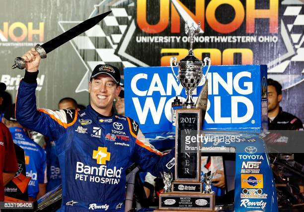 Kyle Busch driver the Banfield Pet Hospital Toyota celebrates in Victory Lane with the winners trophy after winning the NASCAR Camping World Truck...