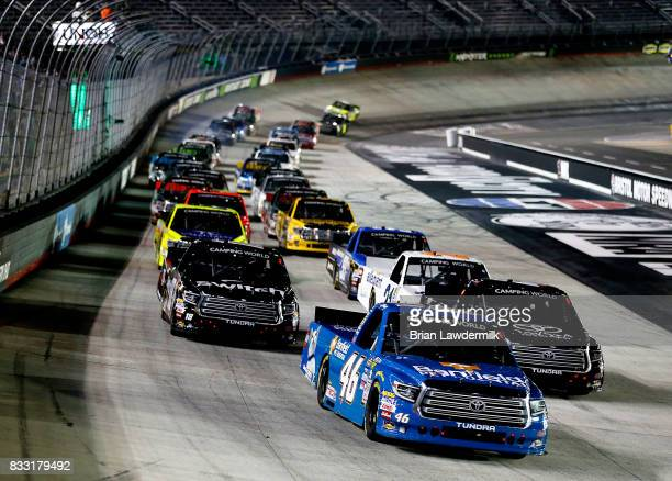 Kyle Busch driver the Banfield Pet Hospital Toyota leads the field during the start of the NASCAR Camping World Truck UNOH 200 at Bristol Motor...