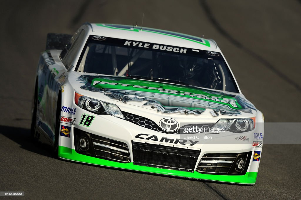 <a gi-track='captionPersonalityLinkClicked' href=/galleries/search?phrase=Kyle+Busch&family=editorial&specificpeople=211123 ng-click='$event.stopPropagation()'>Kyle Busch</a> drives the #18 Interstate Batteries Toyota during qualifying for the NASCAR Sprint Cup Series Auto Club 400 at Auto Club Speedway on March 22, 2013 in Fontana, California.