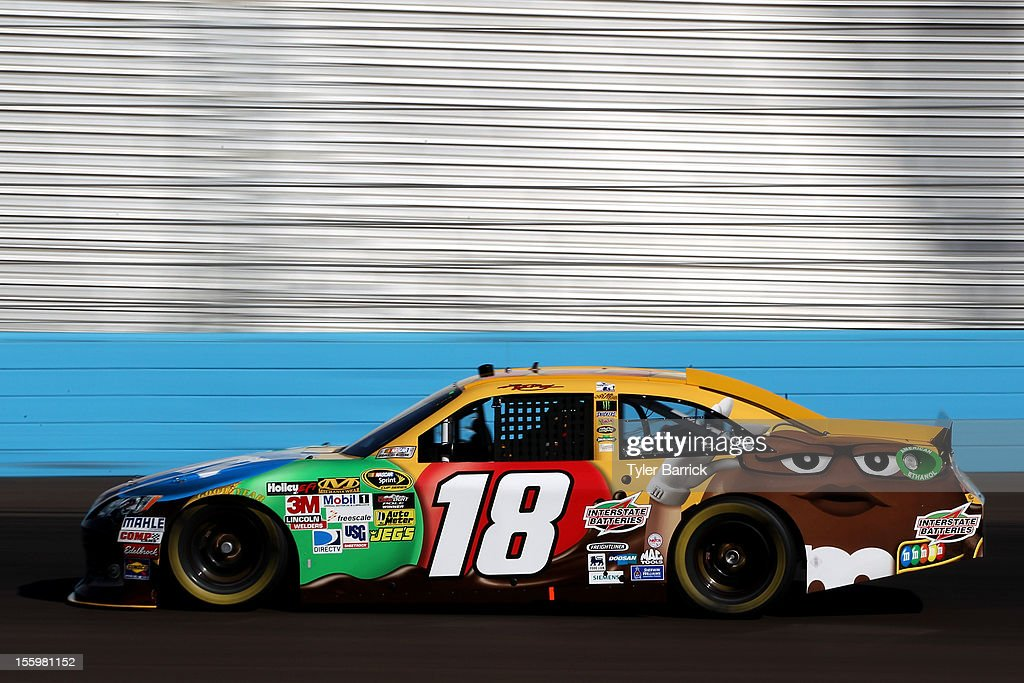 <a gi-track='captionPersonalityLinkClicked' href=/galleries/search?phrase=Kyle+Busch&family=editorial&specificpeople=211123 ng-click='$event.stopPropagation()'>Kyle Busch</a> drives the #18 M&M's Toyota during practice for the NASCAR Sprint Cup Series AdvoCare 500 at Phoenix International Raceway on November 10, 2012 in Avondale, Arizona.