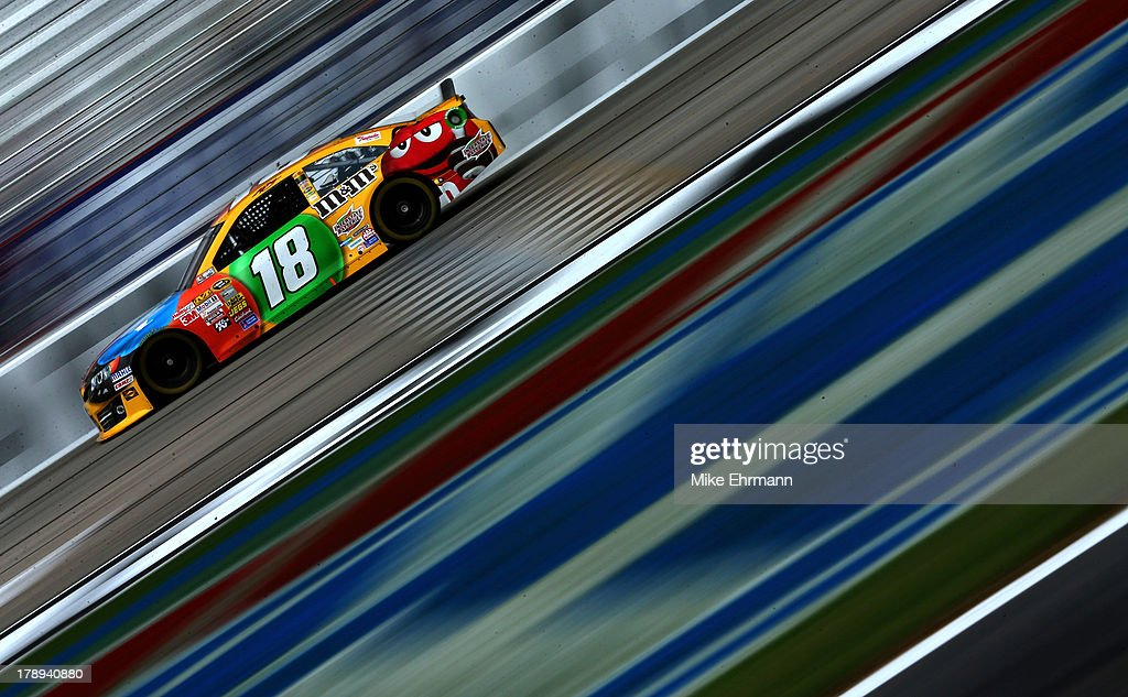 Kyle Busch drives the #18 M&M's Toyota during practice for the NASCAR Sprint Cup Series AdvoCare 500 at Atlanta Motor Speedway on August 31, 2013 in Hampton, Georgia.