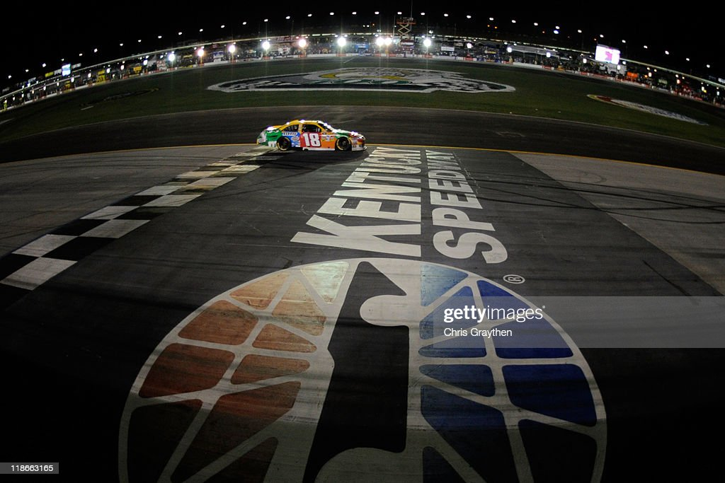 <a gi-track='captionPersonalityLinkClicked' href=/galleries/search?phrase=Kyle+Busch&family=editorial&specificpeople=211123 ng-click='$event.stopPropagation()'>Kyle Busch</a> drives the #18 M&M's Toyota during the NASCAR Sprint Cup Series Quaker State 400 at Kentucky Speedway on July 9, 2011 in Sparta, Kentucky.