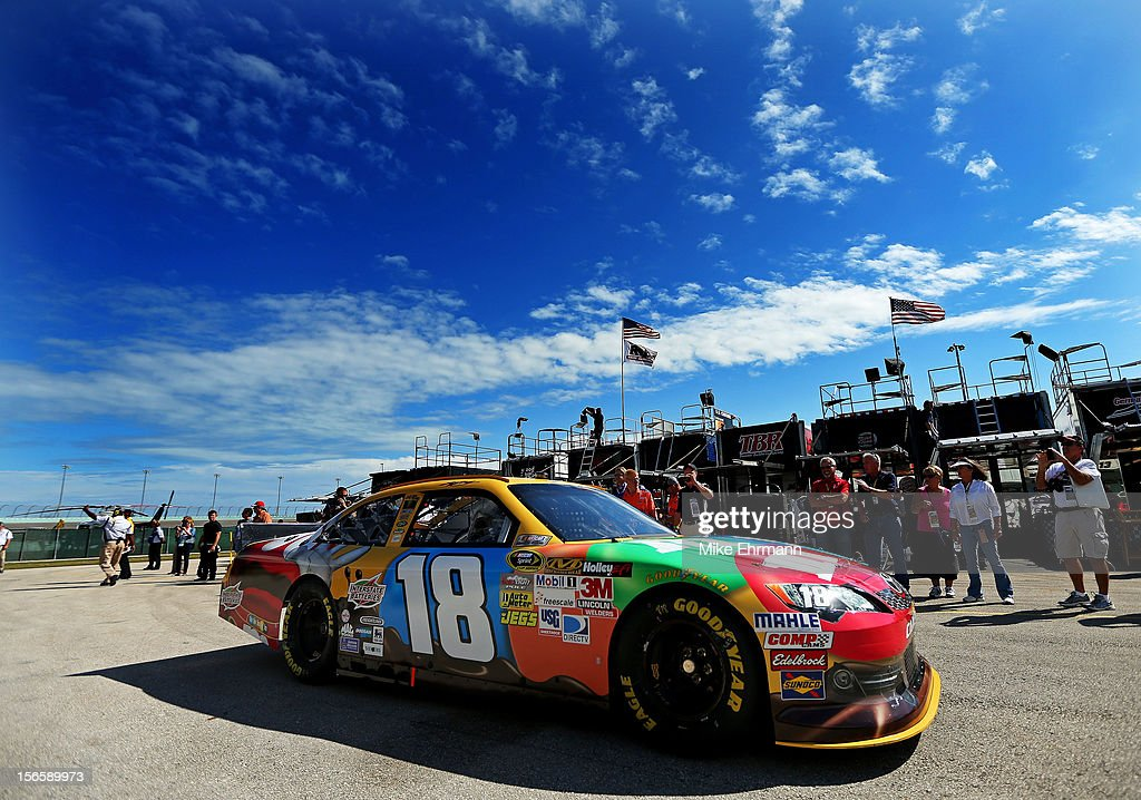 <a gi-track='captionPersonalityLinkClicked' href=/galleries/search?phrase=Kyle+Busch&family=editorial&specificpeople=211123 ng-click='$event.stopPropagation()'>Kyle Busch</a> drives the #18 M&M's Toyota through the garage area during practice for the NASCAR Sprint Cup Series Ford EcoBoost 400 at Homestead-Miami Speedway on November 17, 2012 in Homestead, Florida.