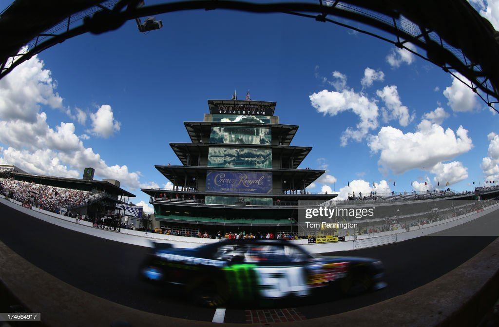 <a gi-track='captionPersonalityLinkClicked' href=/galleries/search?phrase=Kyle+Busch&family=editorial&specificpeople=211123 ng-click='$event.stopPropagation()'>Kyle Busch</a> drives the #54 Monster Energy Toyota during the NASCAR Nationwide Series Indiana 250 at Indianapolis Motor Speedway on July 27, 2013 in Indianapolis, Indiana.