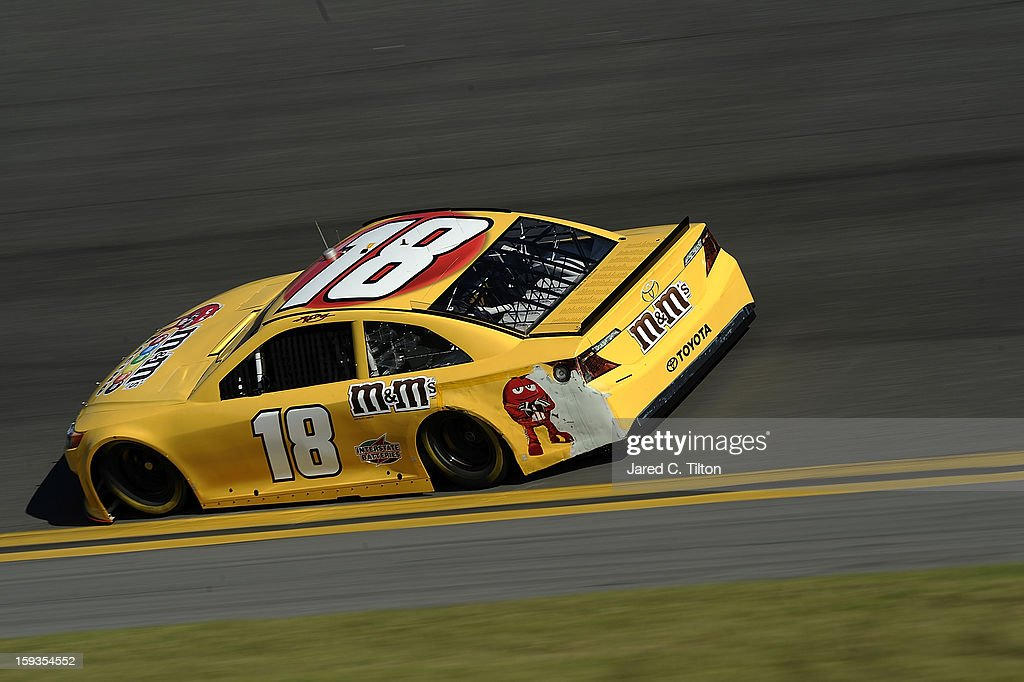 <a gi-track='captionPersonalityLinkClicked' href=/galleries/search?phrase=Kyle+Busch&family=editorial&specificpeople=211123 ng-click='$event.stopPropagation()'>Kyle Busch</a> drives the #18 Toyota during NASCAR Sprint Cup Series Preseason Thunder testing at Daytona International Speedway on January 12, 2013 in Daytona Beach, Florida.