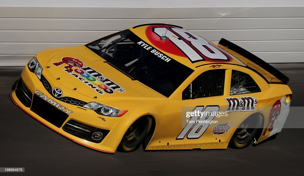 <a gi-track='captionPersonalityLinkClicked' href=/galleries/search?phrase=Kyle+Busch&family=editorial&specificpeople=211123 ng-click='$event.stopPropagation()'>Kyle Busch</a> drives the #18 Toyota during the NASCAR Sprint Cup Preseason Thunder testing at Daytona International Speedway on January 12, 2013 in Daytona Beach, Florida.