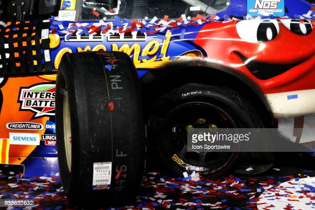 Kyle Busch Joe Gibbs Racing MMs Caramel Toyota Camry crew set aside a tire to replace during the running of the 57th annual Bass Pro Shops NRA Night...
