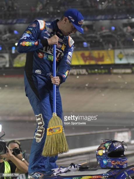 Kyle Busch Joe Gibbs Racing MM's Caramel Toyota Camry with a broom signifying his 'sweep' of all the events this weekend after winning the NASCAR...