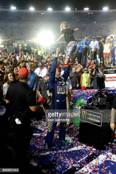 Kyle Busch Joe Gibbs Racing MMs Caramel Toyota Camry with son Braxton after winning the 57th annual Bass Pro Shops NRA Night Race 500 on August 192017