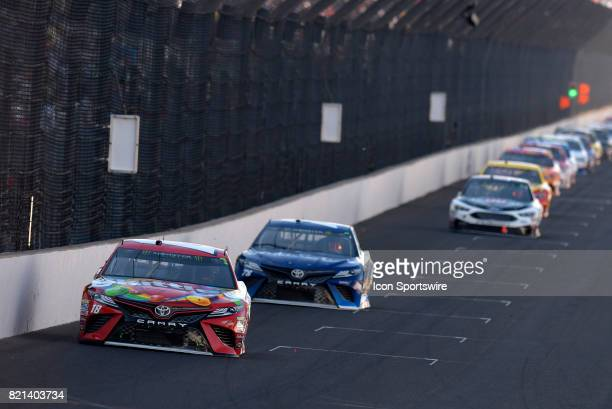 Kyle Busch Joe Gibbs Racing Toyota Camry and Martin Truex Jr Furniture Row Racing Toyota Camry break away from the field in the early stages of the...