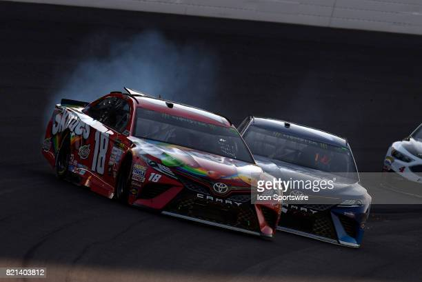 Kyle Busch Joe Gibbs Racing Toyota Camry and Martin Truex Jr Furniture Row Racing Toyota Camry get together on a late restart during the NASCAR...