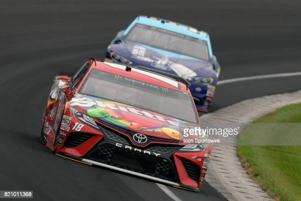 Kyle Busch Joe Gibbs Racing Toyota Camry leads Matt DiBenedetto GO FAS Racing Ford Fusion through turn one during practice for the NASCAR Monster...