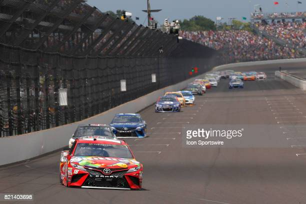 Kyle Busch Joe Gibbs Racing Toyota Camry pulls away from the field going into turn one during the NASCAR Monster Energy Cup Series Brantley Gilbert...