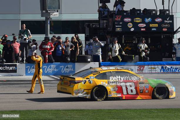 Kyle Busch Joe Gibbs Racing Toyota Camry walks away from his wrecked car in dejection after crashing on the final lap of the race during the Kobalt...