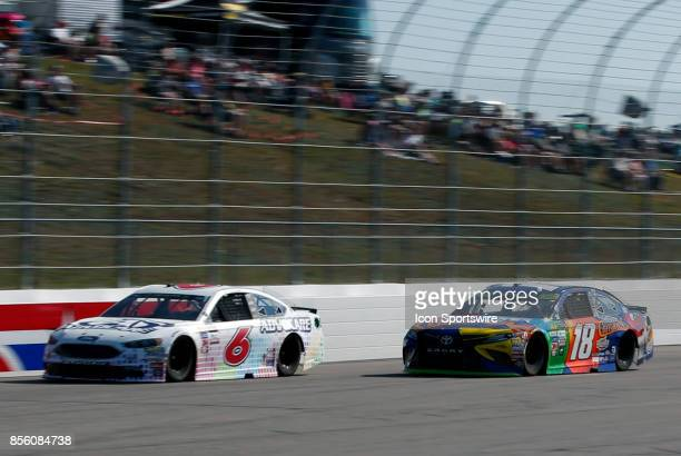 Kyle Busch Monster Energy NASCAR Cup Series driver of the MM's Caramel Toyota overtakes Trevor Bayne Monster Energy NASCAR Cup Series driver of the...