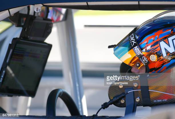 Kyle Busch studies the telemetry in his car during qualifying for the Rinnai 250 NASCAR Xfinity Series race on March 4 at the Atlanta Motor Speedway...