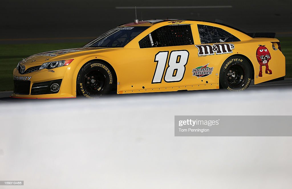 Kyle Busch waits on pit road in the #18 Toyota during the NASCAR Sprint Cup Preseason Thunder testing at Daytona International Speedway on January 11, 2013 in Daytona Beach, Florida.