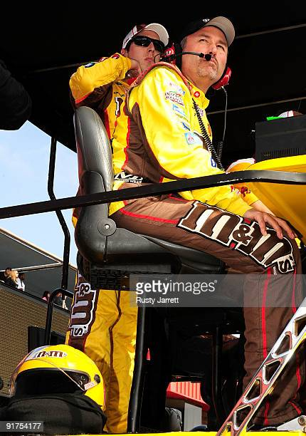 Kyle Busch watches from his pit box after being relieved by David Gilliland in the MM's Toyota during the NASCAR Sprint Cup Series Pepsi 500 at Auto...