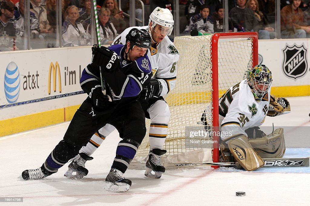 Kyle Calder #19 of the Los Angeles Kings battles for the puck against Mike Ribeiro #63 of the Dallas Stars as goalie Marty Turco #35 protects the net during the first period on January 12, 2008 at Staples Center in Los Angeles, California.