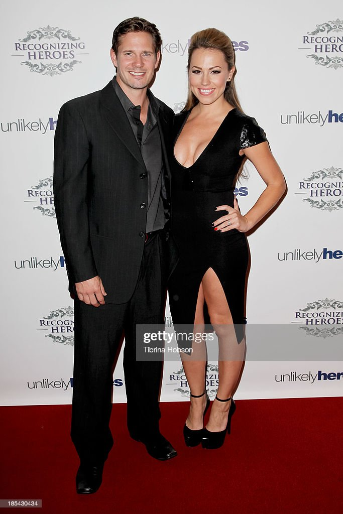 Kyle Carlson and Jessica Hall attend at the Unlikely Heroes' recognizing heroes awards dinner And gala at W Hollywood on October 19, 2013 in Hollywood, California.