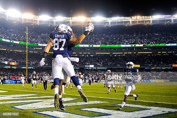 Kyle Carter of the Penn State Nittany Lions celebrates with Geno Lewis after scoring a touchdown in overtime during a game against the Boston College...