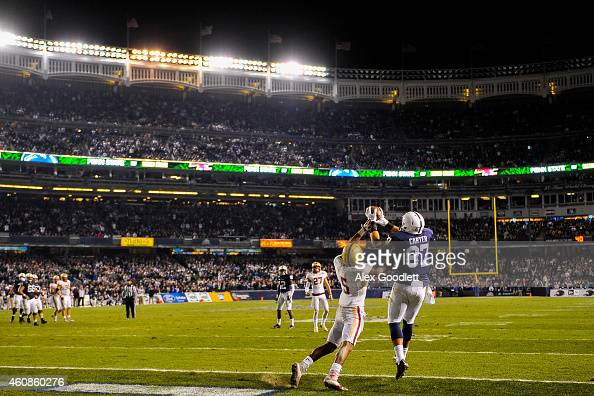 Kyle Carter of the Penn State Nittany Lions makes a touchdown catch over TyMeer Brown of the Boston College Eagles in overtime of the 2014 New Era...