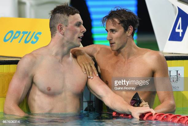 Kyle Chalmers congratulates Cameron McEvoy of Australia on winning the Men's 100m Freestyle during the 2017 Australian Swimming Championships at the...